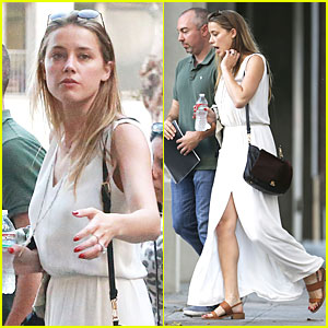 Amber Heard Brings All the Attention to Her Legs in High Slitted Dress