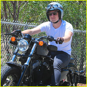 Josh Hutcherson Takes His Motorcycle For A Cruise Around A Park