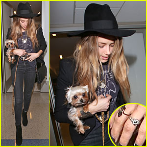 Amber Heard's Ring Finger Takes the Spotlight at LAX Airport