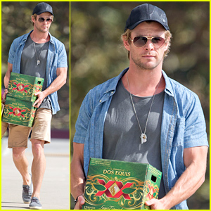 Chris Hemsworth Has No Trouble Carrying Two Cases of Beer & a Grocery Bag to His Car!