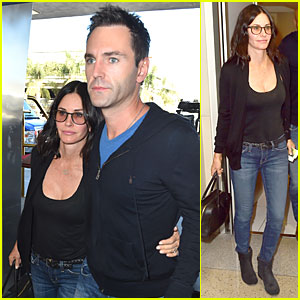 Courteney Cox & Fiance Johnny McDaid Hold Onto Each Other For LAX Departure
