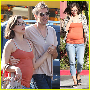Milla Jovovich Is An Orange Slice of Pregnant Heaven During Lunch Date With Husband Paul W.S. Anderson