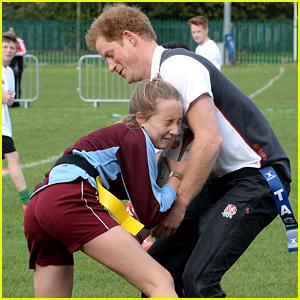 Prince Harry Gets Tackled By a Young Female During a Rugby Game!