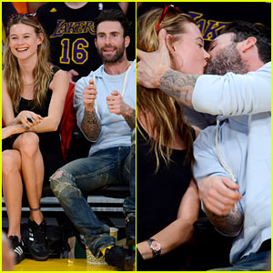 fat kiss on his wife Behati Prinsloo while getting caught on the kiss
