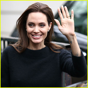 Angelina Jolie Waves to Paris Fans Ahead of 'Unbroken' Premiere