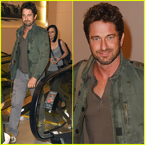 Gerard Butler Catches a Flight with a Brunette Companion