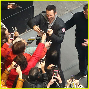 Hugh Jackman Sports a Bandage While Signing Autographs