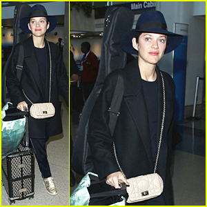 Marion Cotillard Carries Guitar on Her Back at LAX Airport
