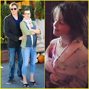 Pregnant Milla Jovovich & Husband Paul W. S. Anderson Show Some PDA