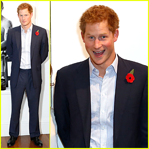 Prince Harry Looks in Awe of Bryan Adams' Wounded Exhibition