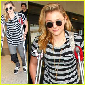 Chloe Moretz Wears Knee Brace & Uses Crutches at LAX Airport