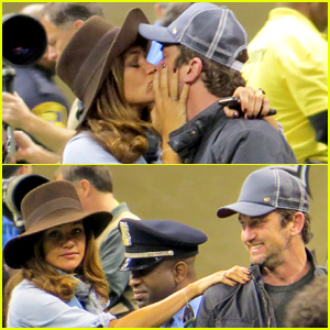 Gerard Butler & Girlfriend Morgan Brown Share Passionate Kiss at the Saints vs. Panthers Game!