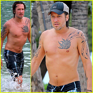 Keith Urban Puts His Shirtless Body on Display While Getting Wet in the Ocean