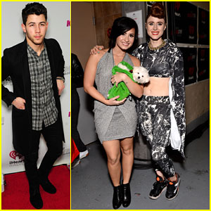 Nick Jonas & Demi Lovato Head to Chicago for the Jingle Ball