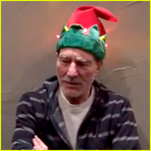 Patrick Stewart Wears a Singing Christmas Hat & His Reaction is Priceless! (Video)