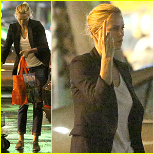 Charlize Theron Flips Off Paparazzi During Rainy Grocery Run