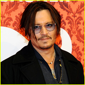 Johnny Depp Dons Trenchcoat to 'Mordecai' Berlin Premiere