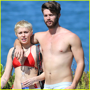 Miley Cyrus & Shirtless Patrick Schwarzenegger Walk Arm-in-Arm While Vacationing in Hawaii