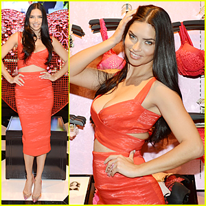 Adriana Lima Shows Major Cleavage in Red Hot Dress at Victoria's Secret