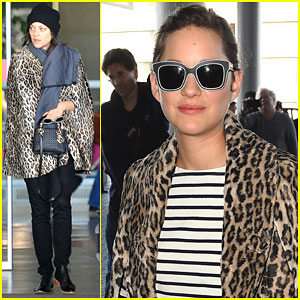 Marion Cotillard Looks Parisienne Chic Arriving in the City of Light