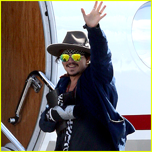 Johnny Depp Leaves Australia with Injured Hand Taped Up