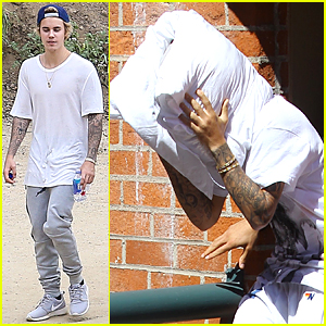 Justin Bieber Hides His Face With a Pillow Again