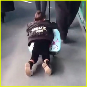 North West Rolls Through the Airport On Her 'Frozen' Suitcase - Watch Now!