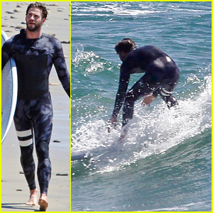 Liam Hemsworth Rocks a Wetsuit for Surfing at the Beach