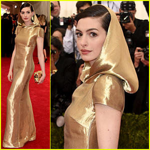 Anne Hathaway Pairs Gold Dress with a Gold Hood at Met Gala 2015