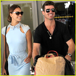 Robin Thicke & April Love Geary Return to L.A. From Paris