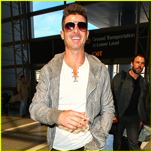 Robin Thicke Can't Stop Smiling at LAX