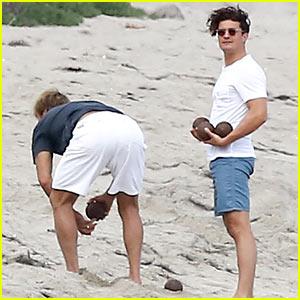 Orlando Bloom Plays Bocce Ball with Surfer Laird Hamilton on Beach