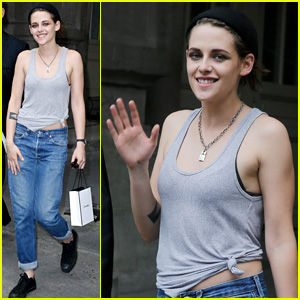 Kristen Stewart Gives Cameras Rare Smile & Wave in Paris