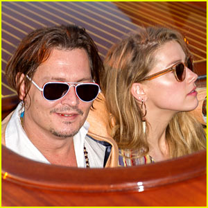 Johnny Depp & Amber Heard Cuddle Up for Venice Boat Ride
