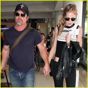 Josh Brolin Holds Hands with His Fiancee at the Airport