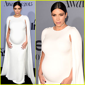 Pregnant Kim Kardashian's Baby Bump Is Prominent in Form-Fitting White Dress