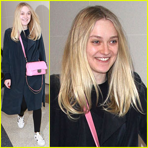 Dakota Fanning Wears a Pop of Pink While Arriving at LAX