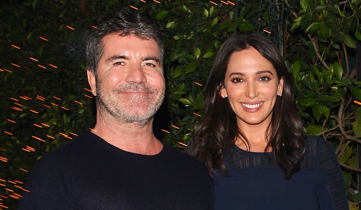 Who is simon cowell dating 2011