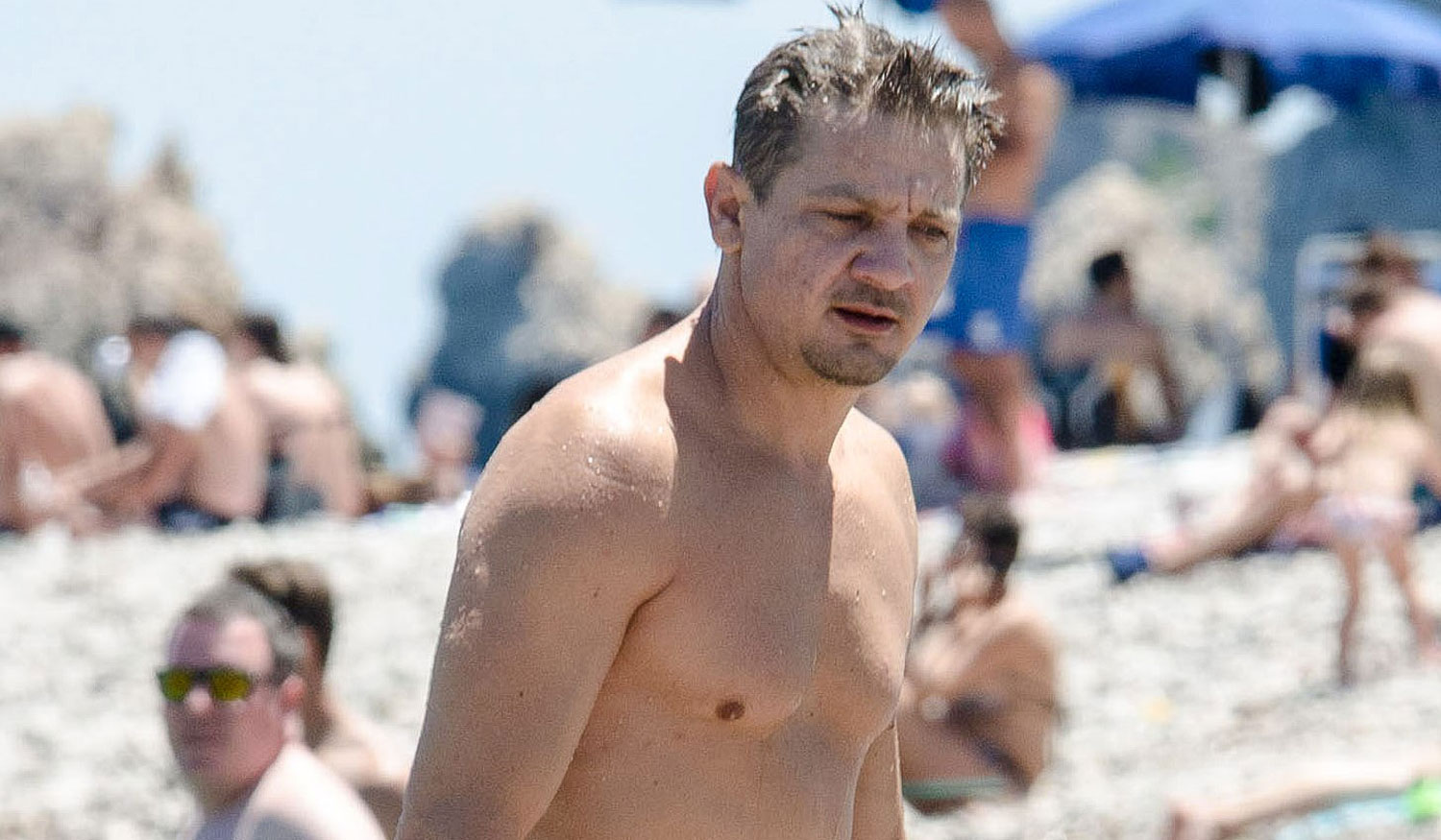 jeremy renner goes shirtless in italy suffers injured