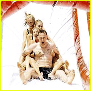 Taylor Swift Embraces Shirtless Tom Hiddleston on Water Slide