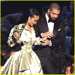 Drake Trips on Rihanna's Dress Backstage at VMAs (Video)
