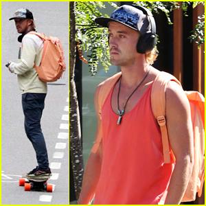 Tom Felton Skates His Way to 'The Flash' Set