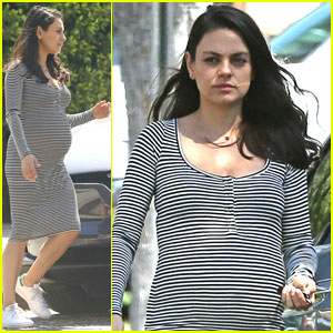 Mila Kunis Shows Off Her Growing Baby Bump in Stripes