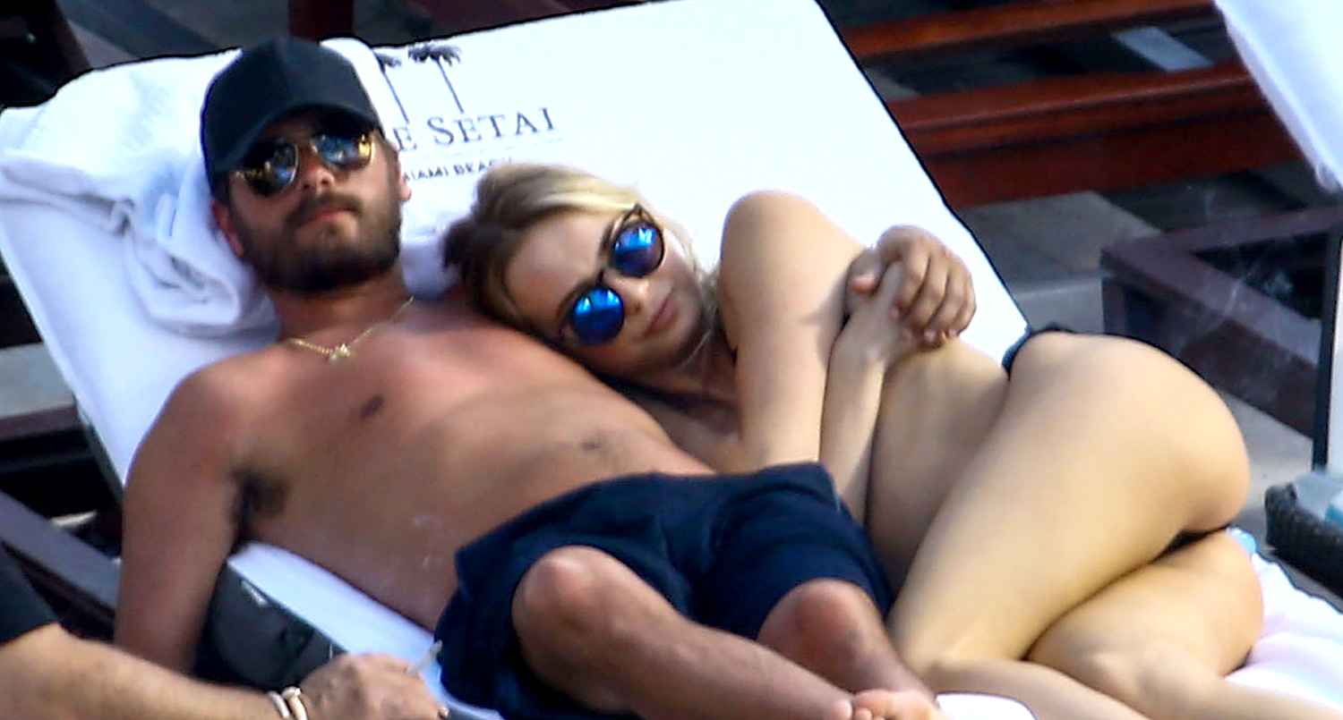 Scott Disick Cuddles By The Pool With Another Woman In