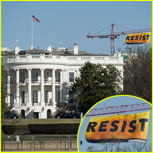 Protesters Climb 270 Foot Crane to Hang 'Resist' Sign Over White House