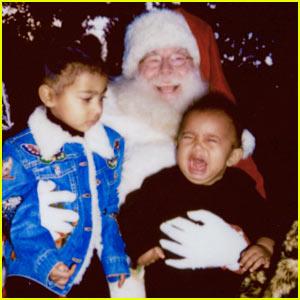 Kim Kardashian Shares Pic of Her Kids Meeting Santa, & Saint is NOT Happy