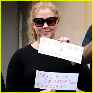 Amy Schumer Holds Signs in Protest Against Betsy DeVos