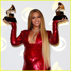 Beyonce Proudly Shows Off Her Two Grammys in Press Room!