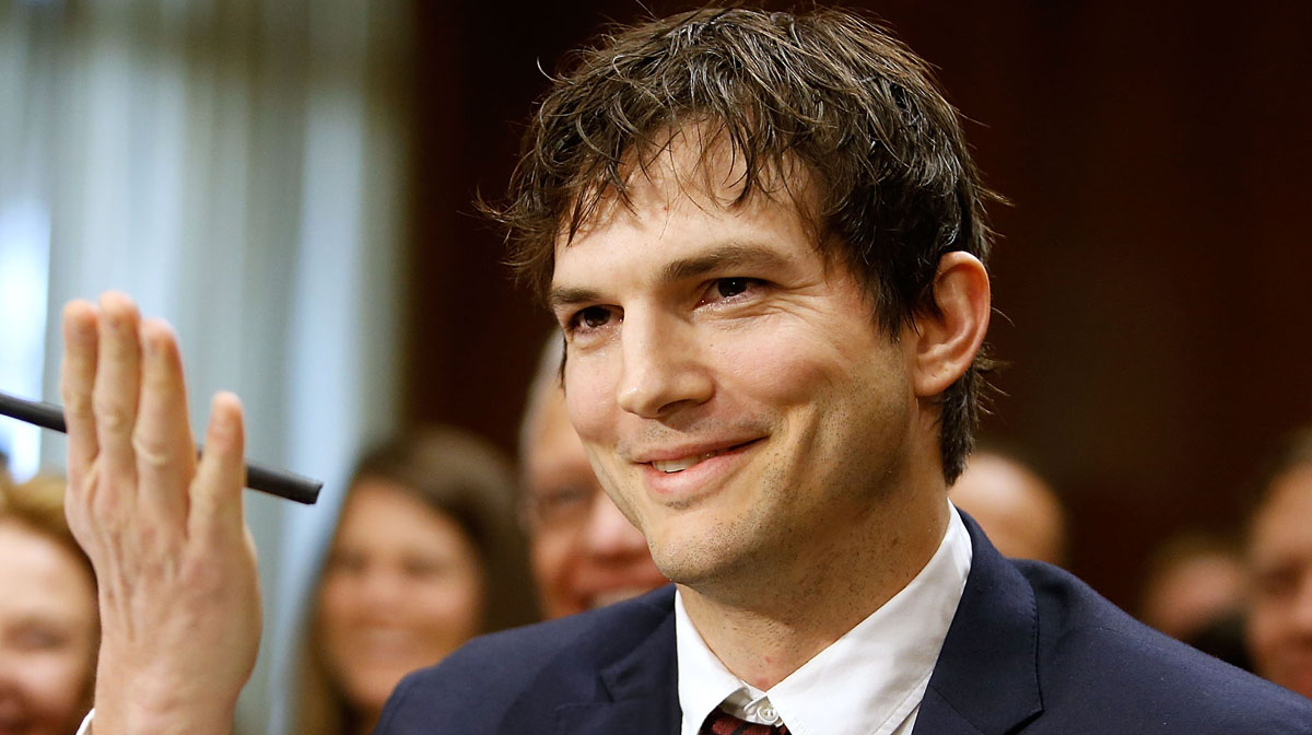 Ashton Kutcher Blows a... Ashton Kutcher