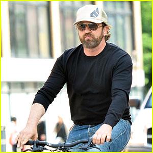Gerard Butler Enjoys Outdoor Meal & Bike Ride Around NYC